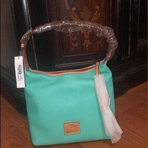 teal Dooney and Bourke handbag